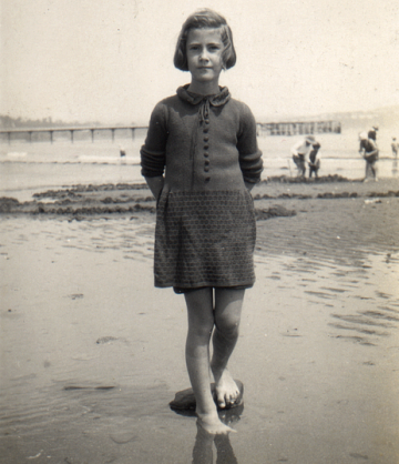 Photo of young girl - Moira Sketch - barefoot on a beach c.1930